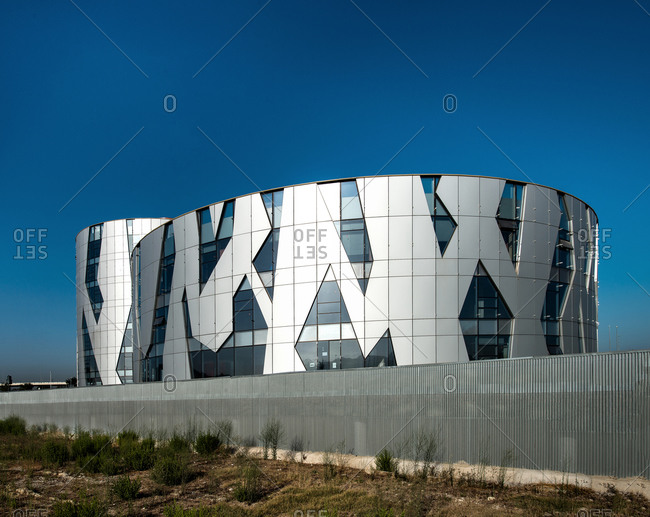 August 22, 2012: Geometric facade of spherical buildings with blue windows against clear sky in Spain