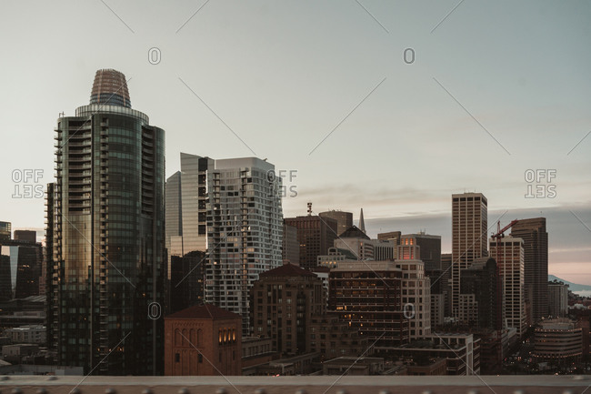 Contemporary district of San Francisco city with modern high rise buildings and skyscrapers against gray cloudy sky during sunrise