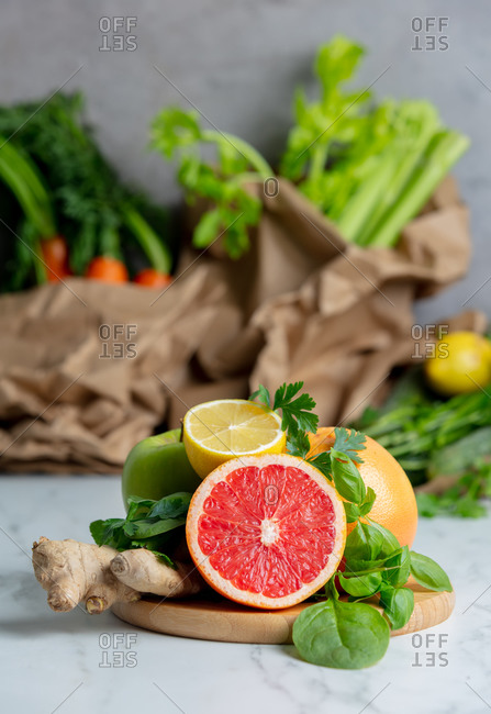 Fresh red orange, parsley, celery, lemon and ginger on a table in summer time season