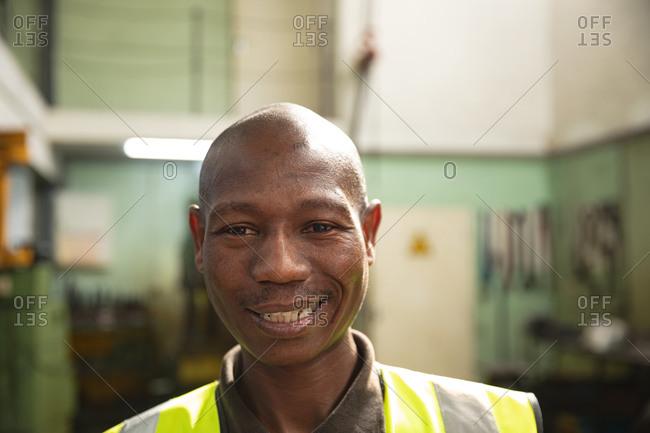 Portrait of a male factory worker wearing a Hi-vis vest