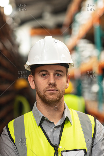 Portrait of a male factory worker wearing a Hi-vis vest and safety helmet