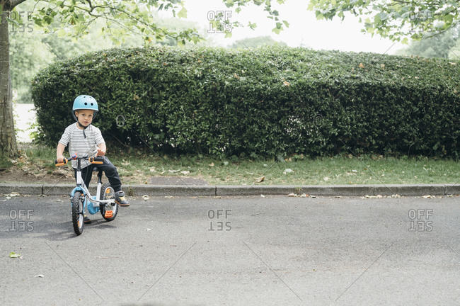 Young boy cycling in park