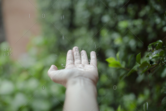First person perspective of water splashing in palm of hand
