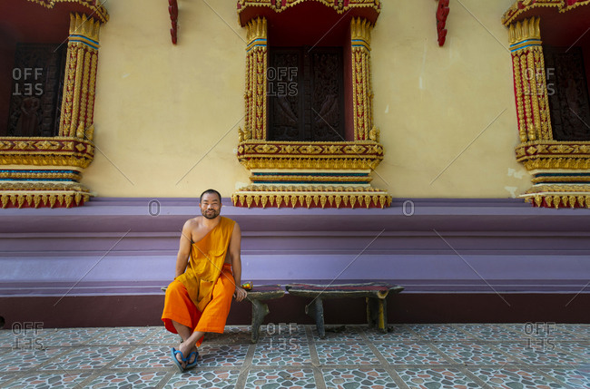 Vientiane, Laos - November 30, 2014: A Buddhist monk outside a temple in Vientiane