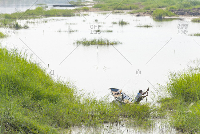 Vientiane, Laos - November 30, 2014: Fisherman in a boat on the Mekong River