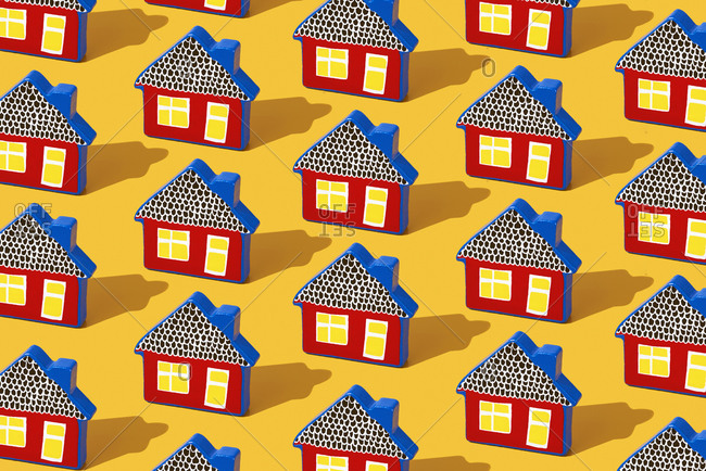 Close up of some toy houses on a yellow background