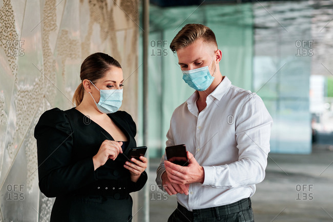 Two executives wearing face masks at the office during coronavirus outbreak