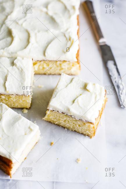 Vanilla sheet cake with whipped lemon buttercream frosting.