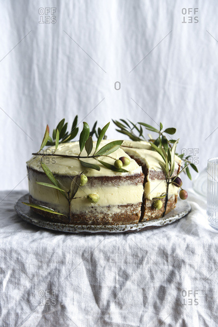 Carrot cake decorated with olive branches