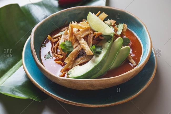 Aztec soup. Close up of mexican fried tortilla soup Sopa Azteca.