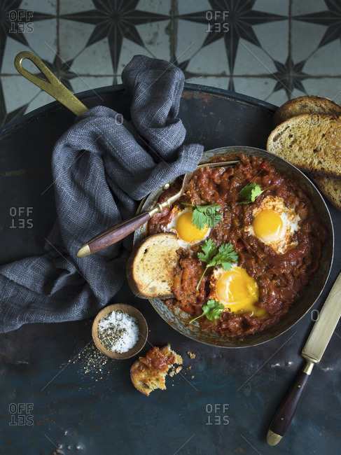 Overhead view serving Shakshuka in a pan