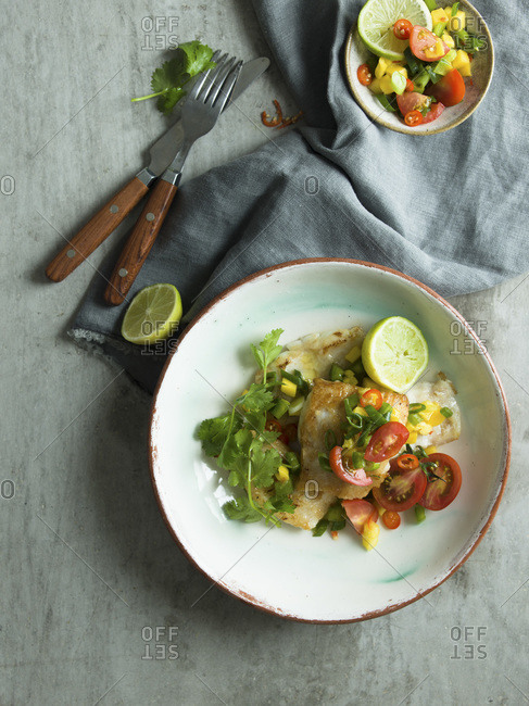 Grilled Fish with salsa. studio shot