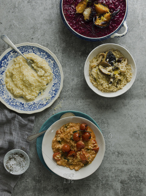 Overhead view of 4 bowls containing soup and risotto studio shot