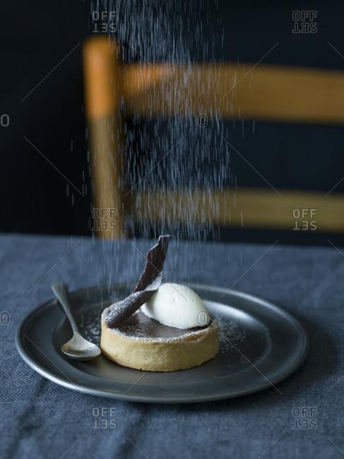Powder sugar dusted Chocolate Tart studio shot
