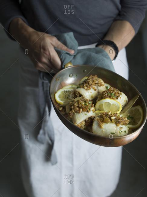 Chef presenting Sole involtini studio shot