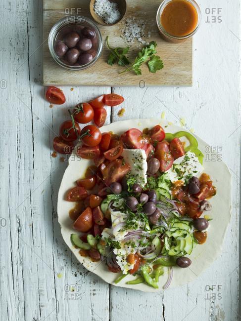 Greek Salad ingredients overhead studio shot