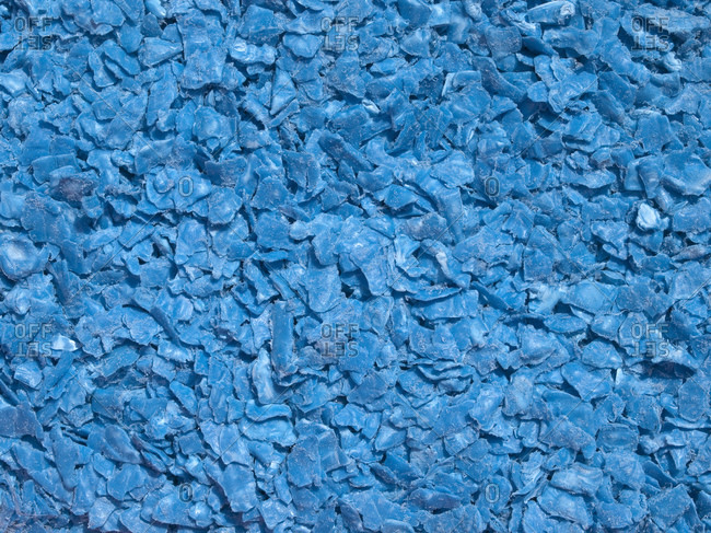 Close-up of recycling in shredded blue plastic