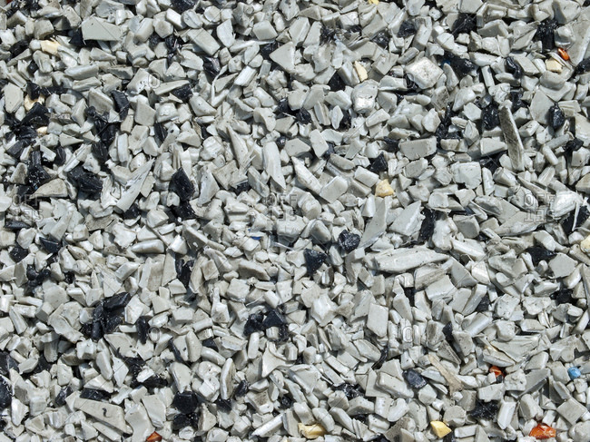 Close-up of recycling in shredded grey plastic