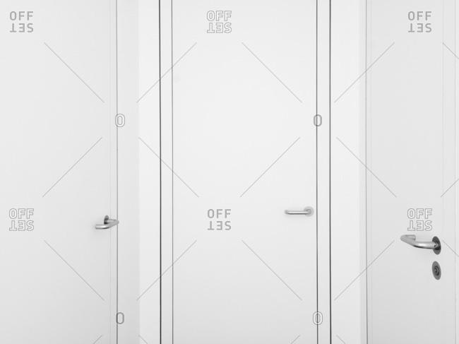 Minimalist white doors in apartment