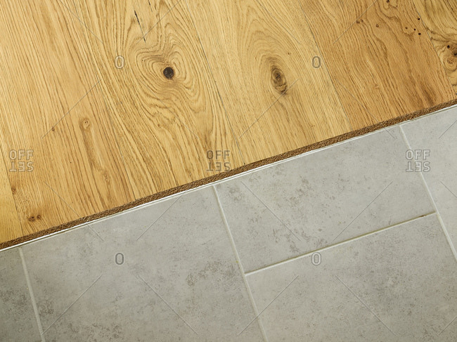 Interior in floor where wood and tile meet