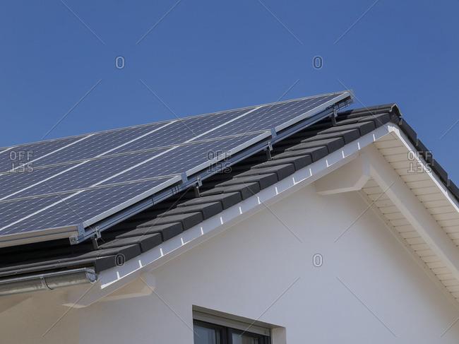 Modern solar panels on residential roof