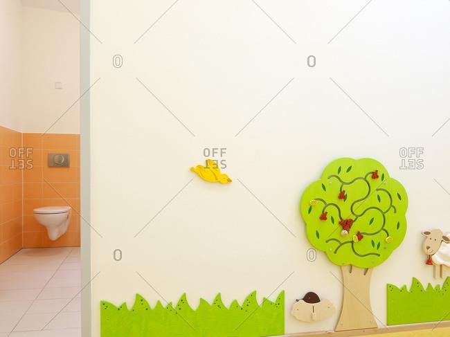 Interactive materials on wall in kindergarten