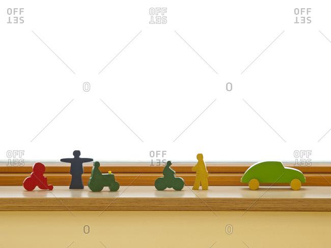 Children's wooden toy on window ledge
