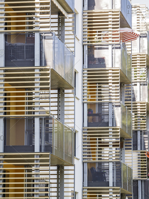 Slatted balconies on building facade