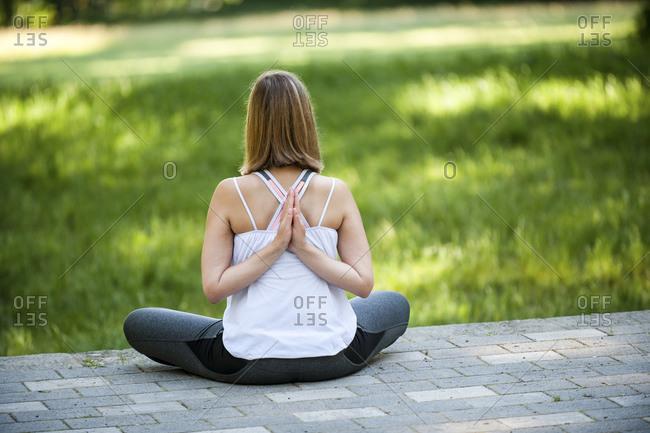 Caucasian woman pratices yoga outside