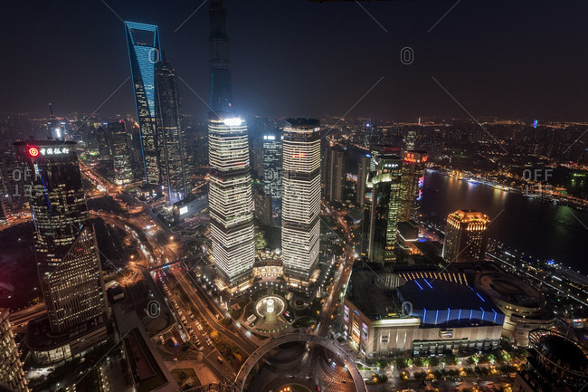 October 21, 2013: Cityscape, view of IFC, SWFC, Jin Mao Tower at night, Lujiazui, Pudong, Shanghai, China