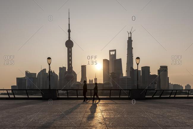 October 20, 2013: Walk on the Bund, waterfront, sunrise, Pudong skyline, Shanghai, China