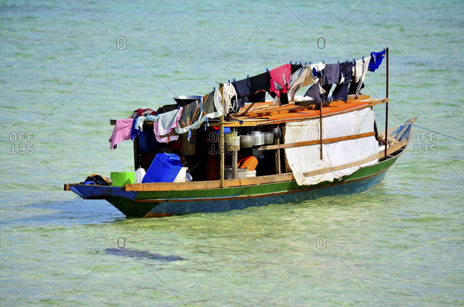 Ethnic minority of the Bajau sea nomads in traditional wooden boats (lepas), Celebes Lake, Malaysia, Southeast Asia