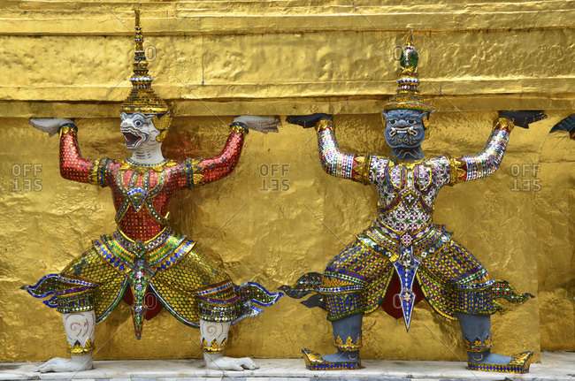 Caryatid sculptures in front of Gold Chedi in the Temple of the Emerald Buddha Wat Phra Kaeo, Grand Palace, Bangkok, Thailand, Southeast Asia
