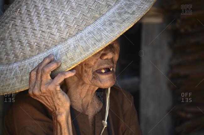 October 17, 2011: Old Toraja woman with traditional hat, Rantepao, Toraja highlands, Tana Toraja, Sulawesi, Indonesia, Southeast Asia