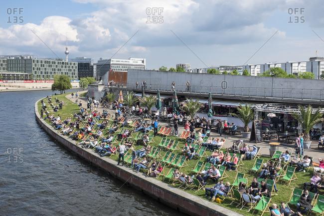 May 1, 2014: Capital Beach, Ludwig-Erhard-Ufer on the Spree, Spreebogen, Berlin Mitte, Germany, Europe