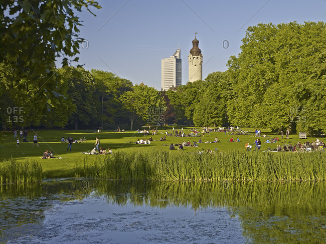 May 31, 2014: Johannapark with a view of the city center on city skyscraper and town hall tower in Leipzig, Saxony, Germany, Europe