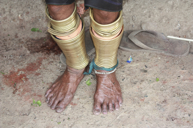 Padaung woman from the Karen tribe with traditional leg jewelry, Thailand, Southeast Asia