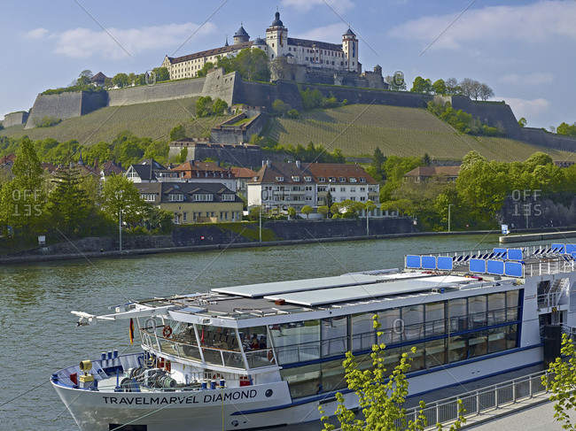April 19, 2014: Marienberg Fortress with excursion boat in Wuerzburg, Lower Franconia, Bavaria, Germany, Europe