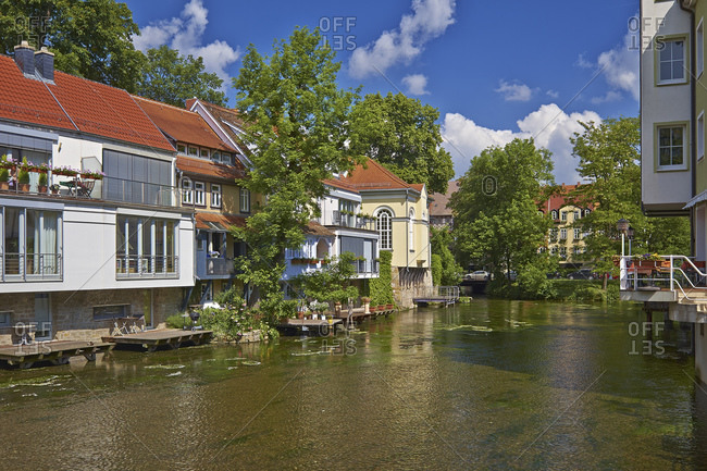 May 31, 2014: Houses and small synagogue on the broad stream of the Gera in Erfurt, Thuringia, Germany, Europe