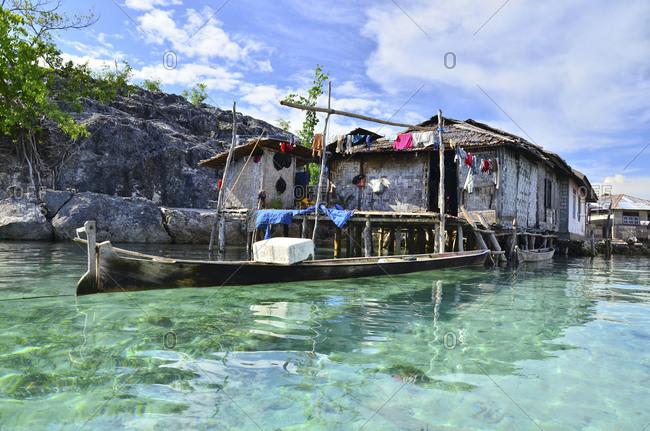 November 27, 2011: Village with stilt houses of the Bajau sea nomads, Malenge Island, Tomini Bay, Togian Islands, Sulawesi, Indonesia