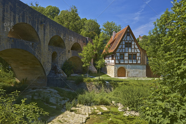 The double bridge with half-timbered house on the Tauber, Rothenburg ob der Tauber, Middle Franconia, Bavaria, Germany