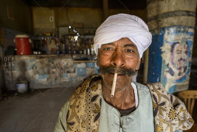 March 31, 2014: Sahara desert man in traditional tea house with shisha, Farafra oasis, Egypt