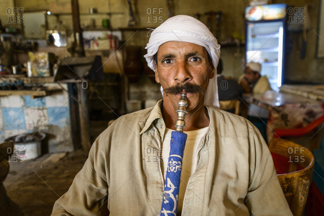 March 31, 2014: Sahara desert man in traditional tea house with shisha, Farafra oasis, Egypt