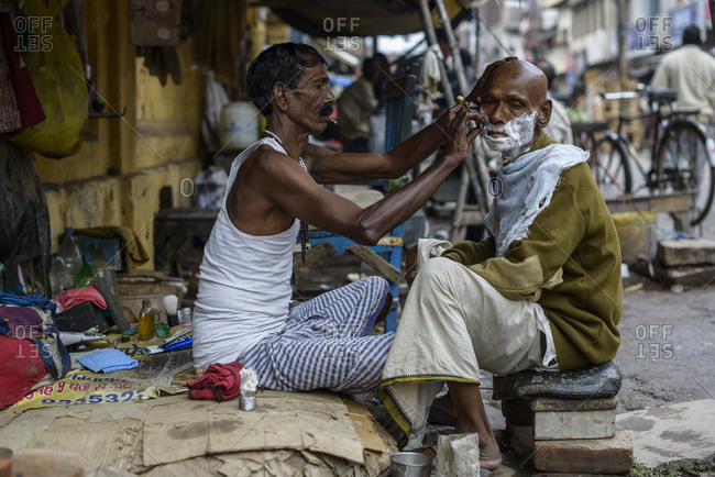 March 1, 2014: Barbers on the streets of Varanasi, India