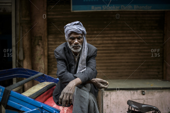 March 11, 2014: Bicycle rickshaw driver rests, Old Delhi, India