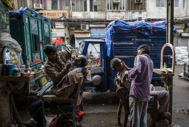 March 11, 2014: Barbers on the streets of Old Delhi, India