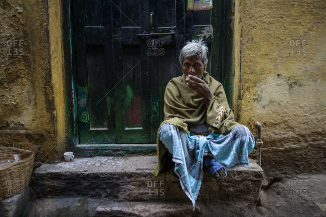 February 28, 2014: Drinking tea in the streets of old Varanasi, India
