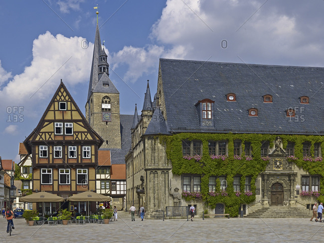 August 8, 2014: Market with town hall and town church St. Benedikti, view in the Hoken, gastronomy at the market, Quedlinburg, Saxony-Anhalt, Germany