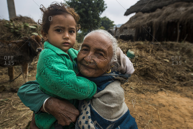 February 10, 2014: Grandmother and granddaughter in a Nepalese village, West Terai, Nepal