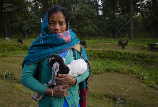 February 11, 2014: Woman with baby goat, West Terai, Nepal